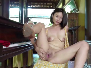 Asian Girl plays the piano, shows off her private parts and pees (Kylie NG)