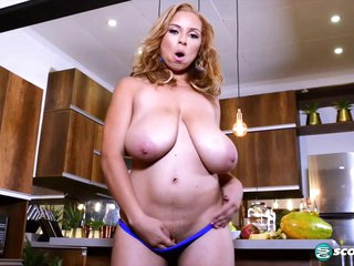 Shara Lopez is playing with her massive milk jugs, while she is alone in the kitchen