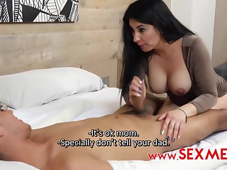 Sexy ebony woman with big tits is giving a dick massage to a handsome younger guy